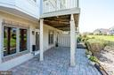 Stone patio on the lower level - 18359 EAGLE POINT SQ, LEESBURG