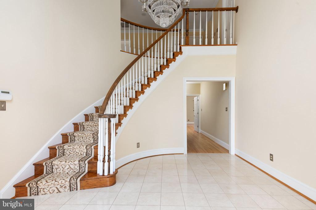 Two story Foyer with crystal chandelier - 2405 OAKMONT CT, OAKTON
