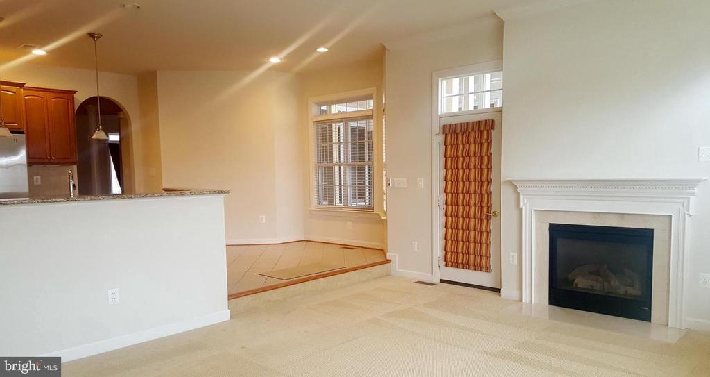Family room with fireplace - 24905 EARLSFORD DR, CHANTILLY