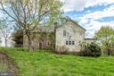Another view of the back side and addition - 19525 TELEGRAPH SPRINGS RD, PURCELLVILLE