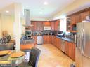 Large kitchen with another dining area - 1035 S IRONWOOD RD, STERLING