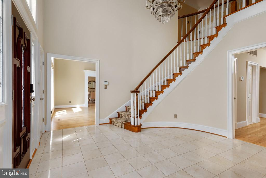 Foyer with curved staircase & marble flooring - 2405 OAKMONT CT, OAKTON