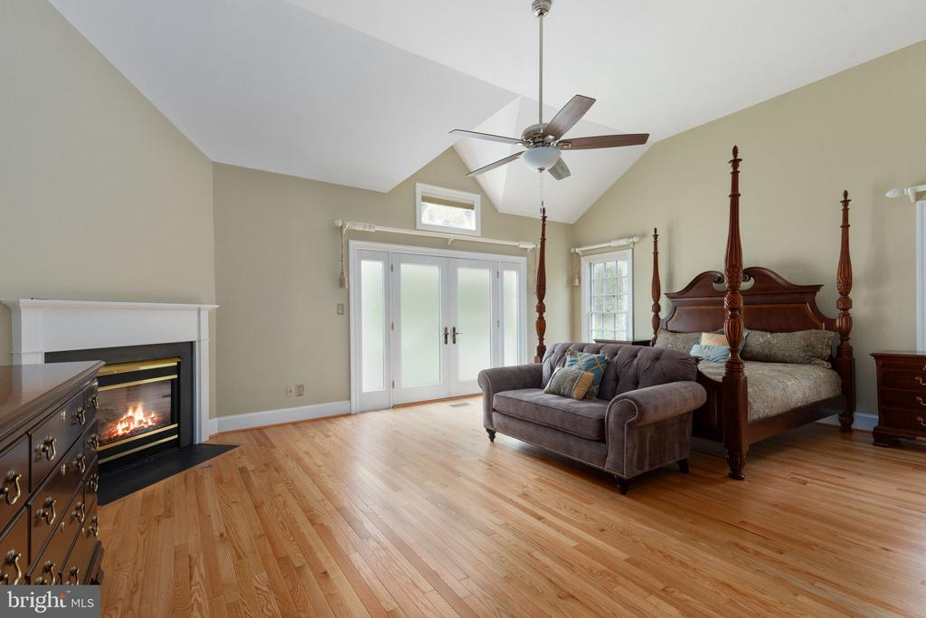 Main Level Primary Bedroom with Fireplace - 2405 OAKMONT CT, OAKTON