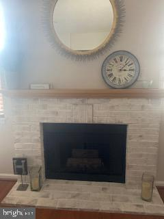 gas fireplace with brick surround - 20303 BEECHWOOD TER #303, ASHBURN