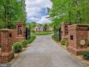 Grand entrance with custom iron gates - 11009 HAMPTON RD, FAIRFAX STATION