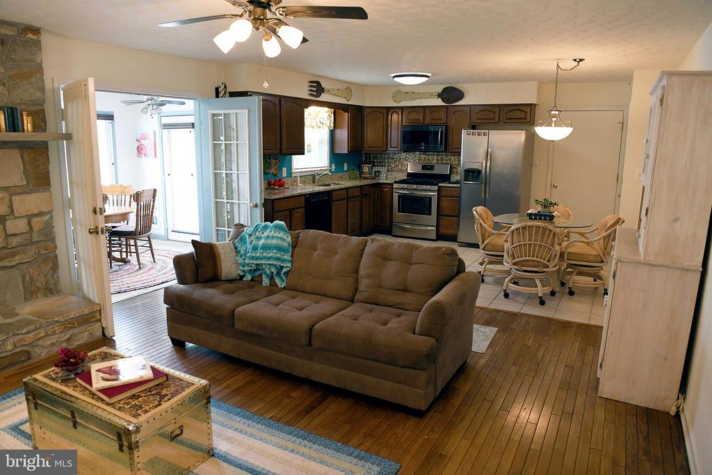 Family rm into kitchen and french doors to sunroom - 312 SYCAMORE DR, FREDERICKSBURG