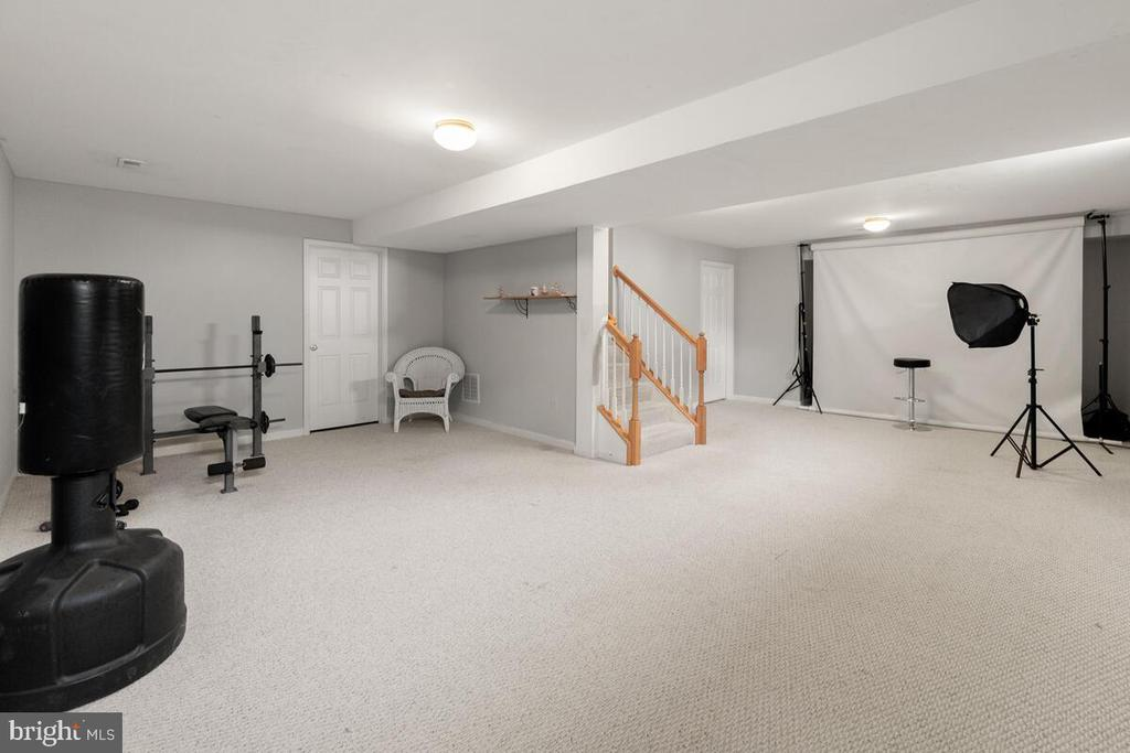 Spacious finished portion of basement - 2104 BEAR CREEK CT, FREDERICK