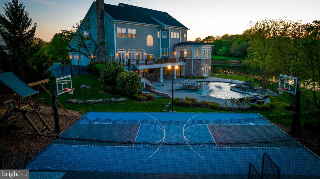 SPORT COURT W/ 2 BASKETBALL HOOPS - 23068 CHARMAY POND PL, BRAMBLETON