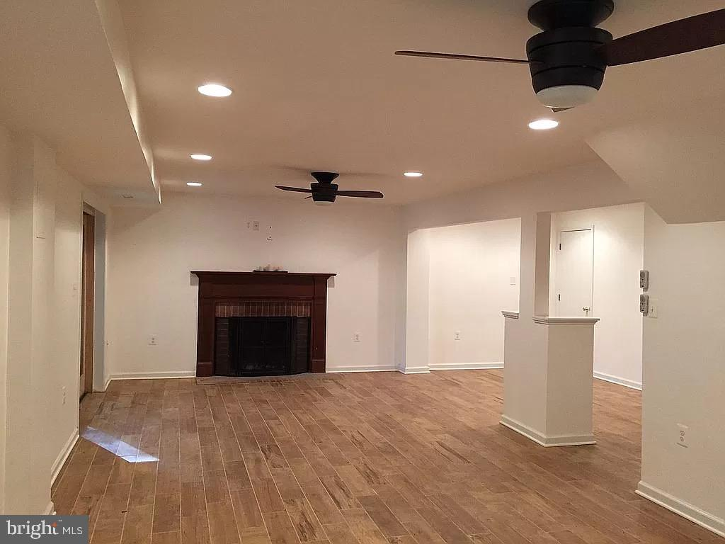 Recreation room with wood burning fireplace - 1829 WAINWRIGHT DR, RESTON