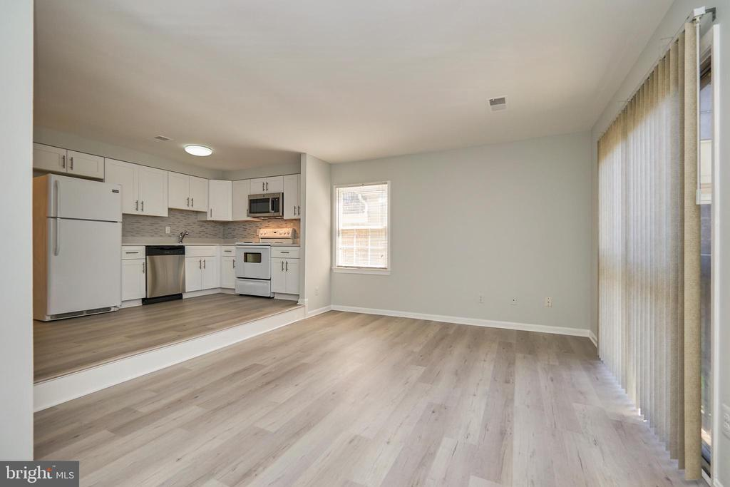 Spacious living room with sliding glass door - 104-B N BEDFORD ST, ARLINGTON