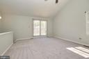 Sliding glass doors lead to private balcony - 104-B N BEDFORD ST, ARLINGTON