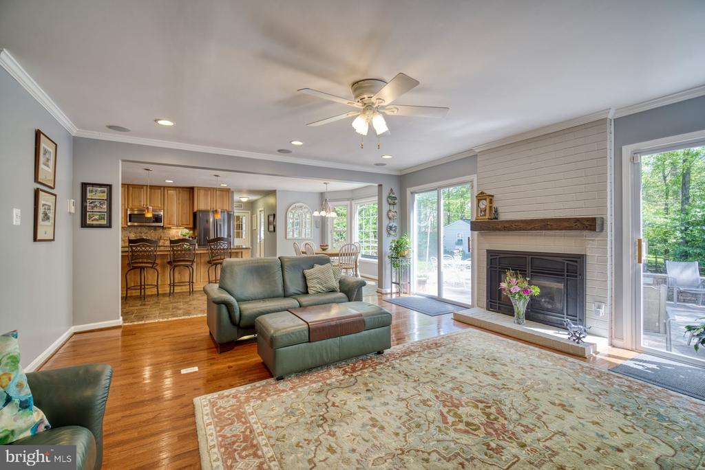Family Room with gas fireplace and access to patio - 2645 BLACK FIR CT, RESTON