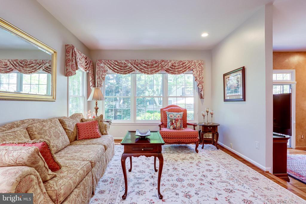 Living room opens to family room. - 1206 WOODBROOK CT, RESTON