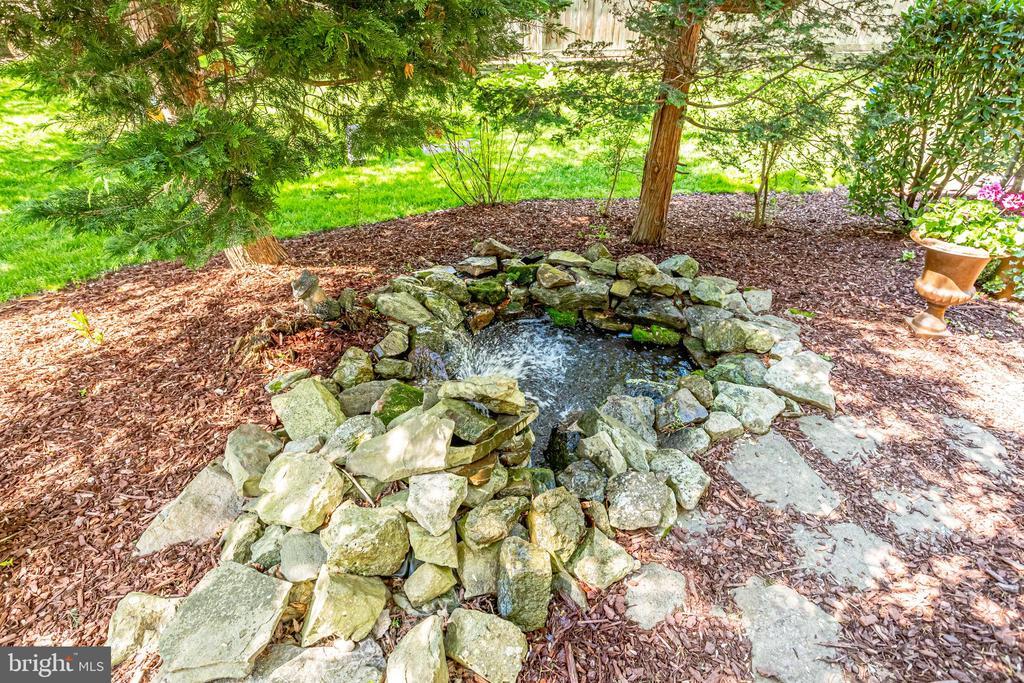 Professional pond in backyard. - 1206 WOODBROOK CT, RESTON