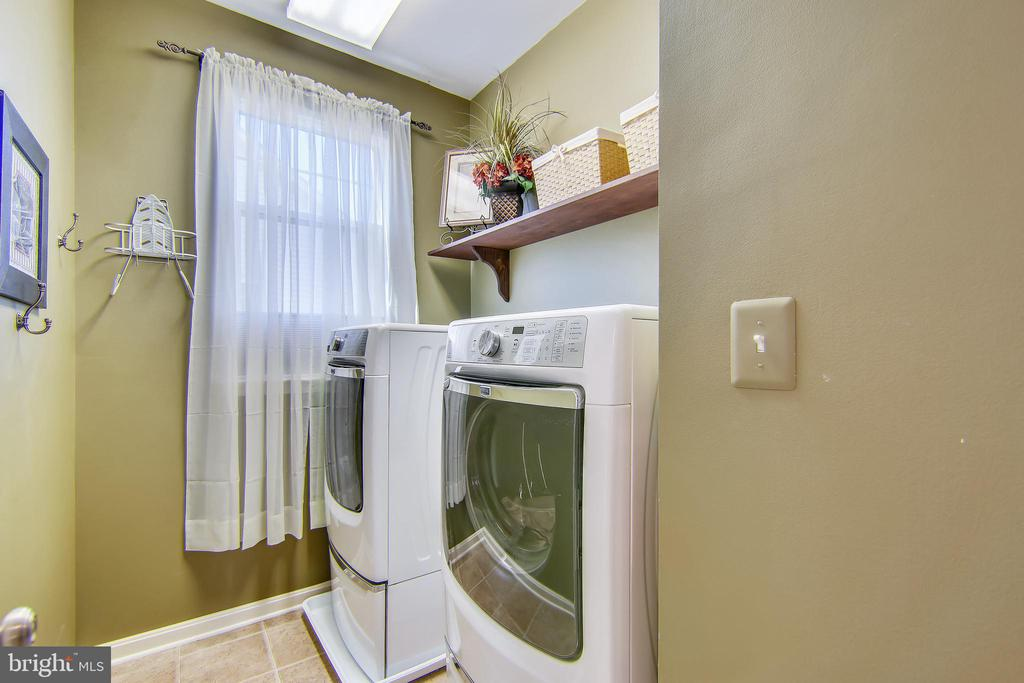 Laundry room conveniently located on upper level - 23397 MORNING WALK DR, BRAMBLETON