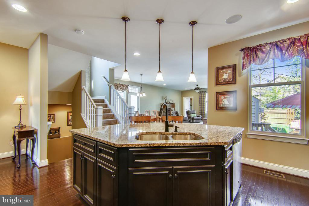 Kitchen opens to the family room area - 23397 MORNING WALK DR, BRAMBLETON