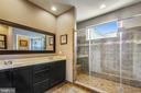 Owners en-suite bath with spa shower - 23397 MORNING WALK DR, BRAMBLETON
