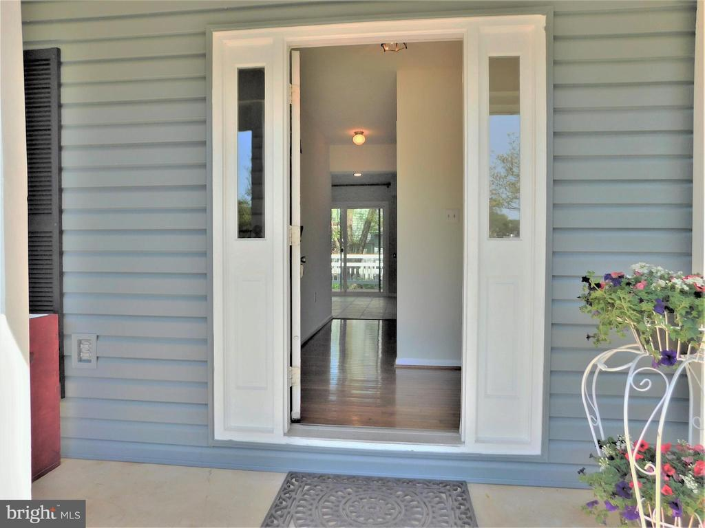 Covered porch entry  to Gunstock hardwood foyer - 12520 BROWNS FERRY RD, HERNDON