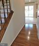 Gunstock hardwoods in ML hallway and staircase - 12520 BROWNS FERRY RD, HERNDON