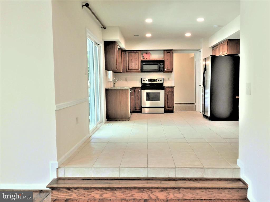 Long view of kitchen & b-fast area from Family Rm - 12520 BROWNS FERRY RD, HERNDON