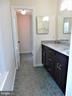 Primary Bathroom:  newer vanity/lites/shower/floor - 12520 BROWNS FERRY RD, HERNDON
