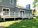 Rear view of Trex deck with white spindles & posts - 12520 BROWNS FERRY RD, HERNDON