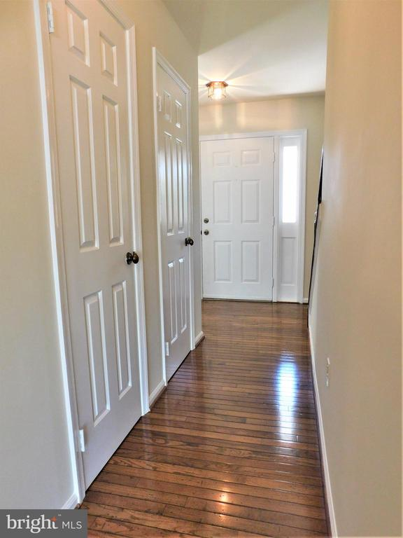 Hardwoods flow into 2 hallway coat closets - 12520 BROWNS FERRY RD, HERNDON
