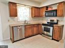 Newer granite countertop/faucet/pendant light - 12520 BROWNS FERRY RD, HERNDON