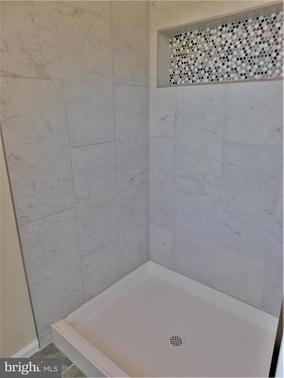 12-floor tile & shower surrounds w custom insert - 12520 BROWNS FERRY RD, HERNDON