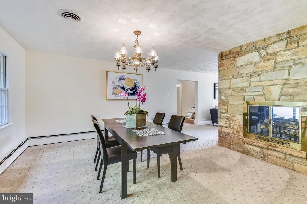 Dining room with 2 sided wood burning fire place - 3033 KNOLL DR, FALLS CHURCH