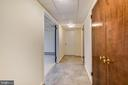 Hallway with closets on lower level - 3033 KNOLL DR, FALLS CHURCH