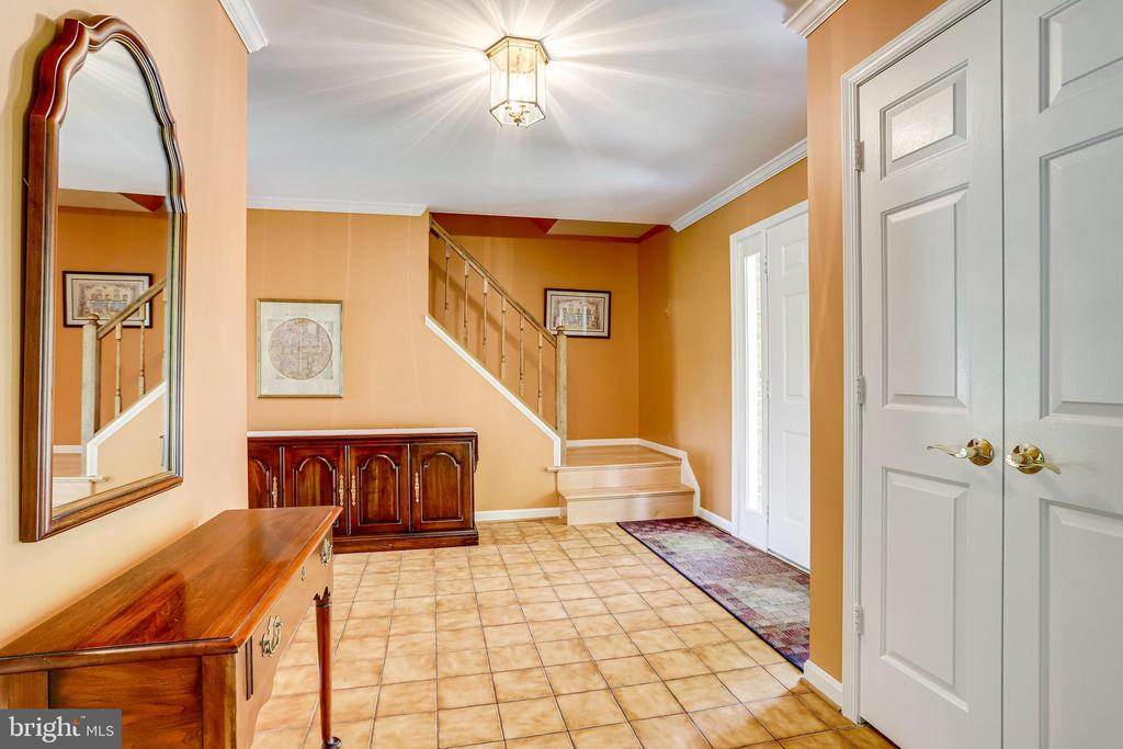 Foyer with stairs to upper level bedrooms - 19 GRISWOLD CT, POTOMAC FALLS