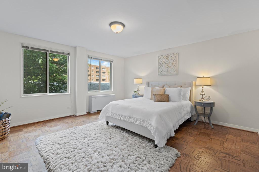 Primary Bedroom with two oversized windows - 1200 N NASH ST #240, ARLINGTON
