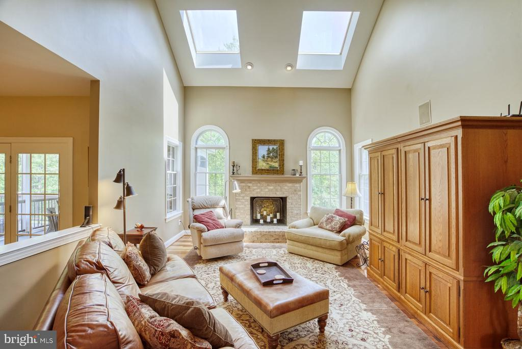 Family Room with Fireplace and Cathedral Ceiling - 1269 COBBLE POND WAY, VIENNA