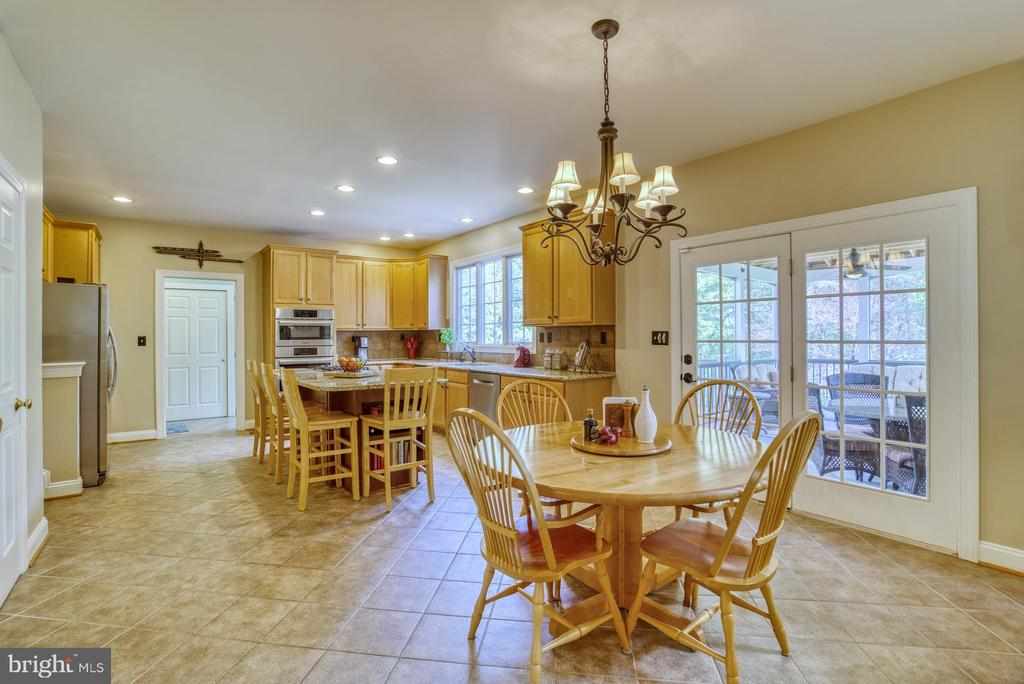 Kitchen with French door to Screened Porch & Deck - 1269 COBBLE POND WAY, VIENNA