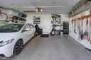 A Car Lovers Dream Garage at the rear of the home. - 42624 LEGACY PARK DR, BRAMBLETON