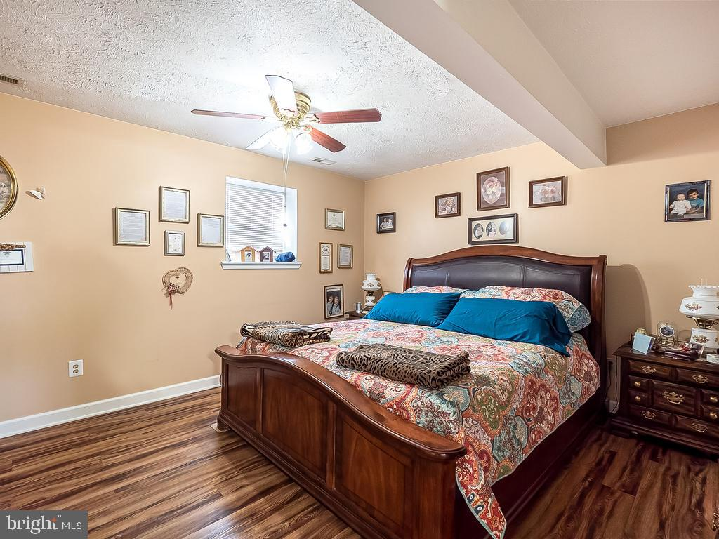 Head to thelower level for private primary bedroom - 4 BERTRAM BLVD, STAFFORD