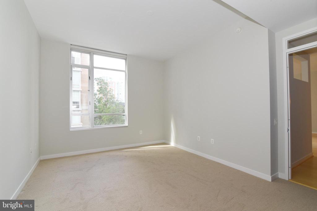 Spacious Primary Bedroom with views of the trees - 12025 NEW DOMINION PKWY #311, RESTON