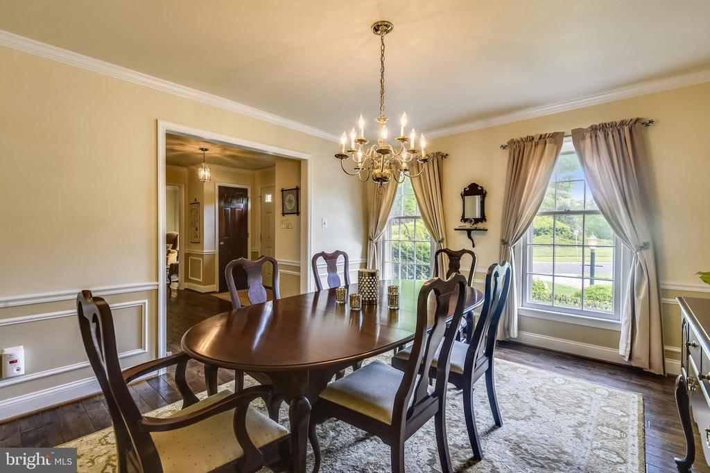 Spacious dining room with wainscoting - 11949 GREY SQUIRREL LN, RESTON