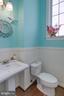 Main level powder room with HW flooring - 24960 ASHGARTEN DR, CHANTILLY