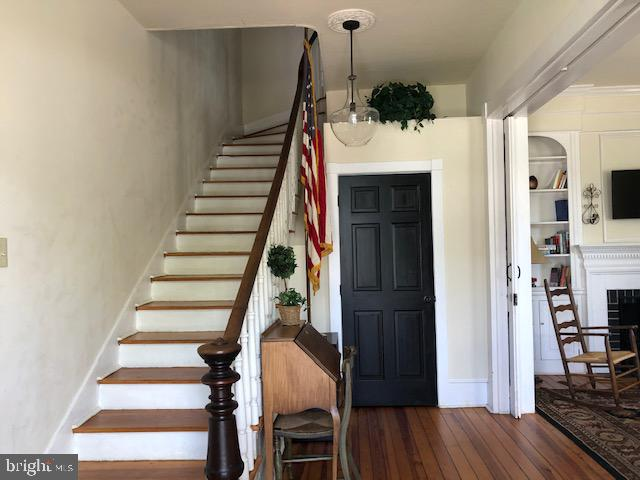 Pocket doors and 1/2 bath for main level. - 310 AMHERST ST, WINCHESTER
