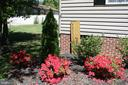 Beautiful landscaping in front lawn - 301 BURR DR, RUTHER GLEN