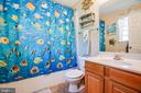 Primary en suite boasts a tub/shower combo - 301 BURR DR, RUTHER GLEN