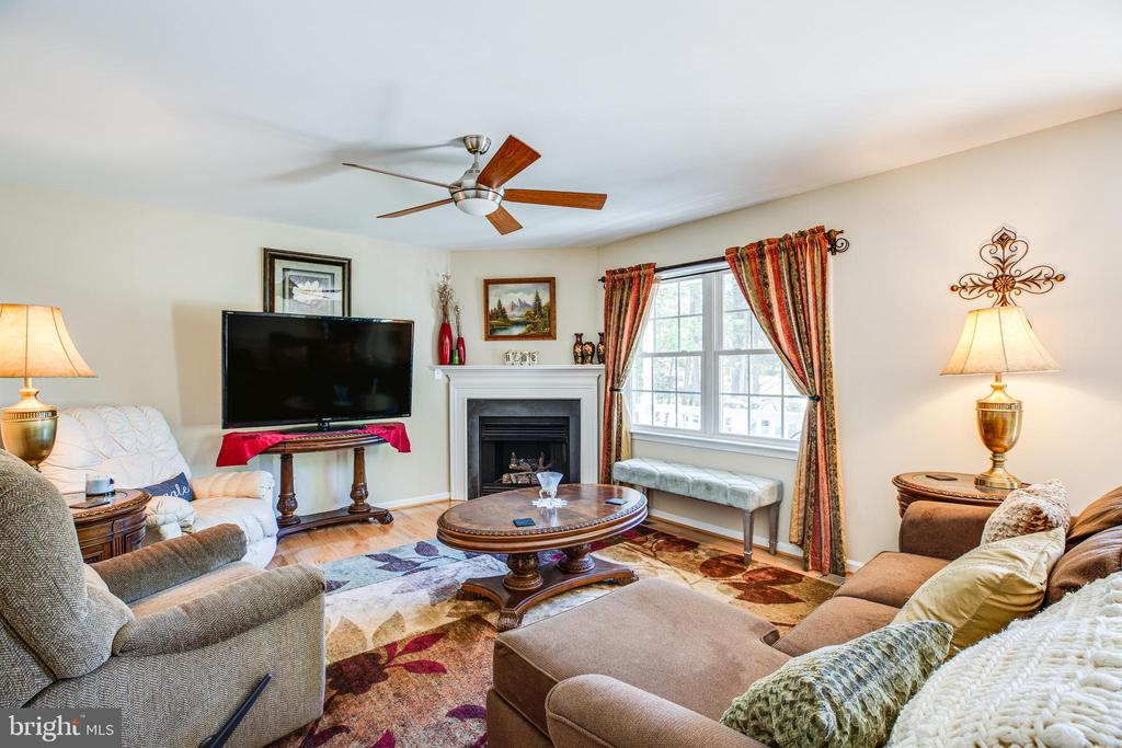 Open-concept living area has a gas log fireplace - 301 BURR DR, RUTHER GLEN