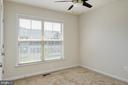 Third upstairs bedroom with ceiling fan - 42740 OGILVIE SQ, ASHBURN