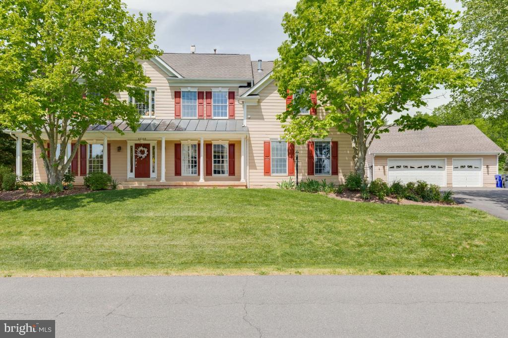 Alt view of home with detached garage - 42308 GREEN MEADOW LN, LEESBURG