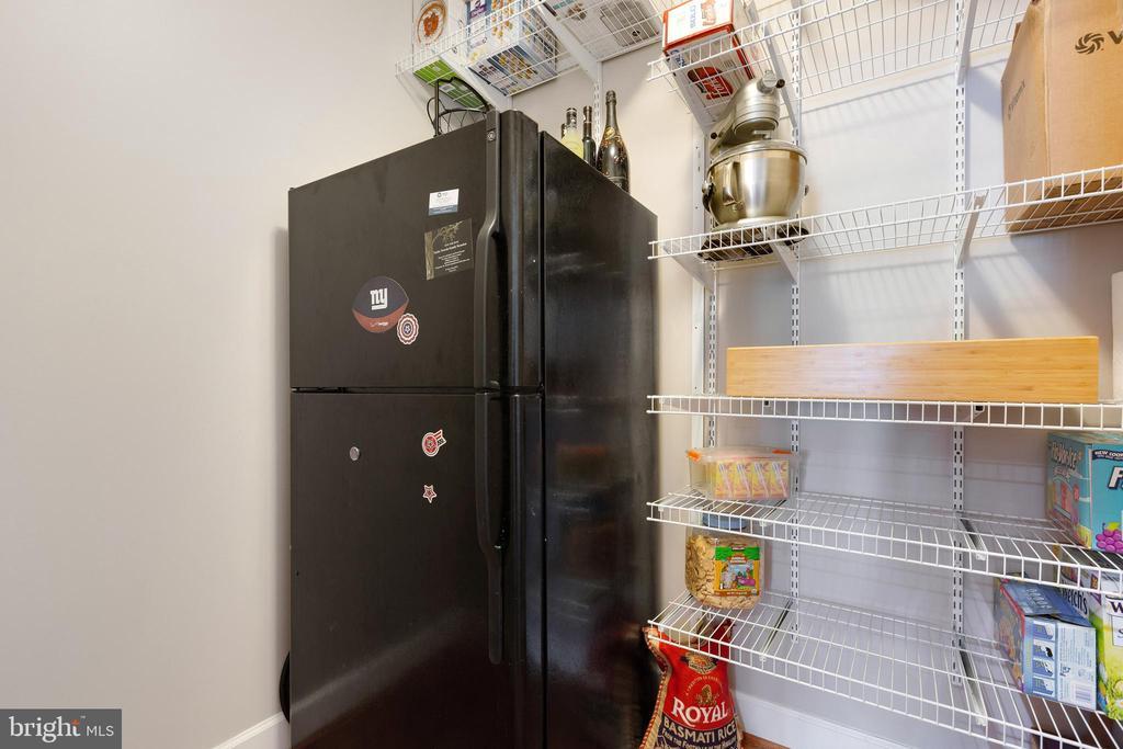 Main level storage room with built in shelving - 15080 ADDISON LN, WOODBRIDGE