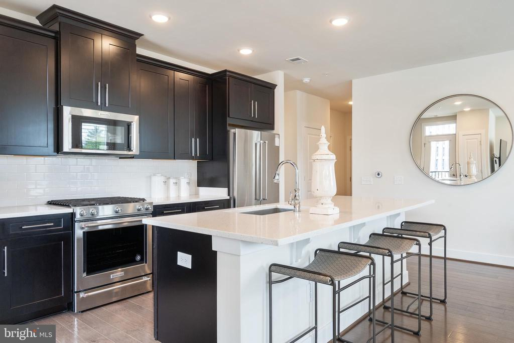 Kitchen with gorgeous quartz island - 11200 RESTON STATION BLVD #301, RESTON