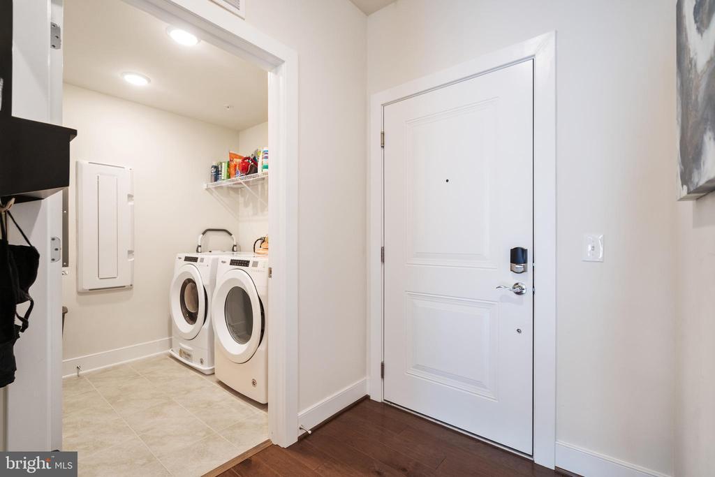 Laundry room view off entry hall - 11200 RESTON STATION BLVD #301, RESTON