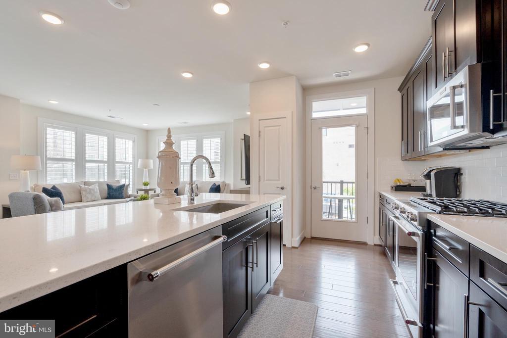 Kitchen view from refridgerator - 11200 RESTON STATION BLVD #301, RESTON